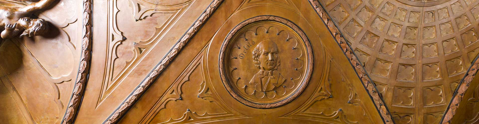 Wooden sculptures and wood carved scientists portraits on the Mazzolini Giuseppucci pharmacy's furnitures